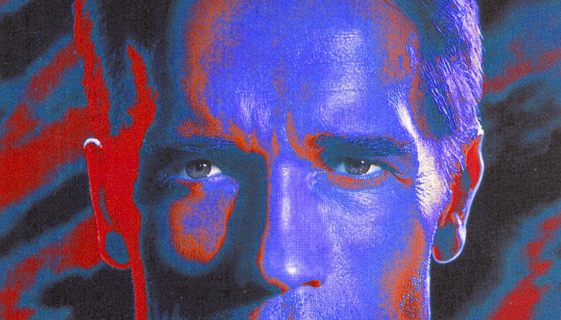 Arnold Schwarzenegger's eyes stare at us in a promotional image for the movie.