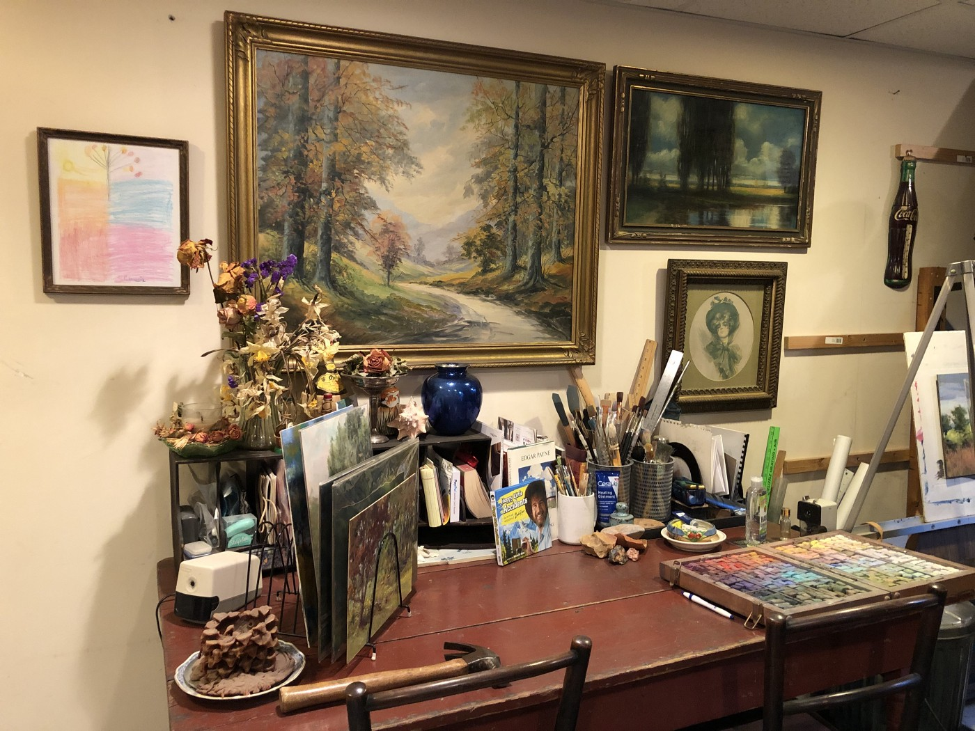 Personal Items In My Studio, wall art, box of pastels and family memorabilia—photo courtesy of the author Marsha Hamby Savage