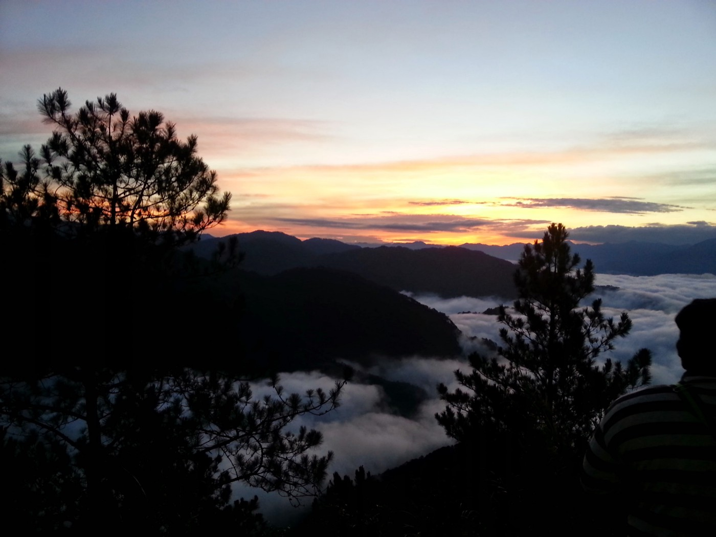 Sunrise in the mountains above the clouds.