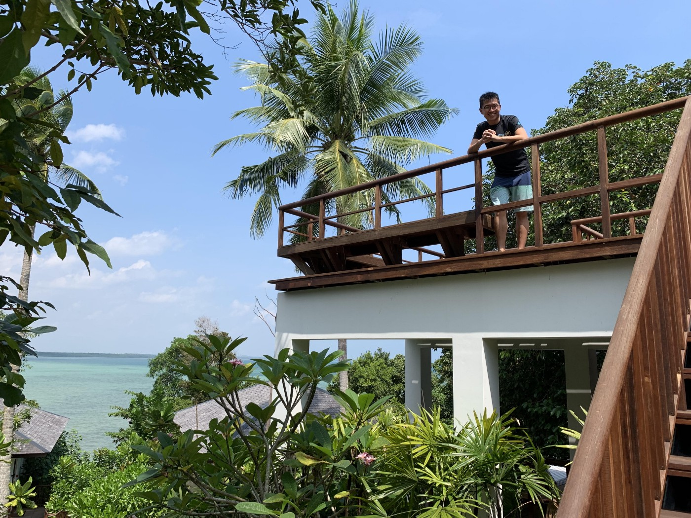 Author standing at the balcony of a beach resort.