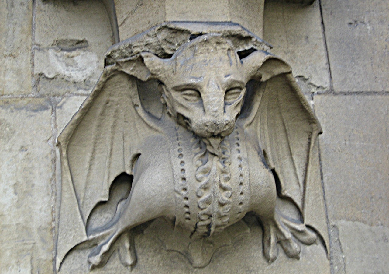 A stone dragon on a building in London, England