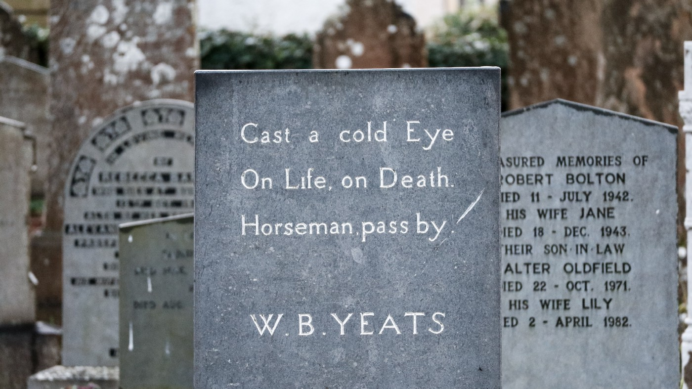 "Headstone in a cemetery reads ""Cast a cold Eye, On Life On Death. Horseman pass by -W.B. Yeats"""