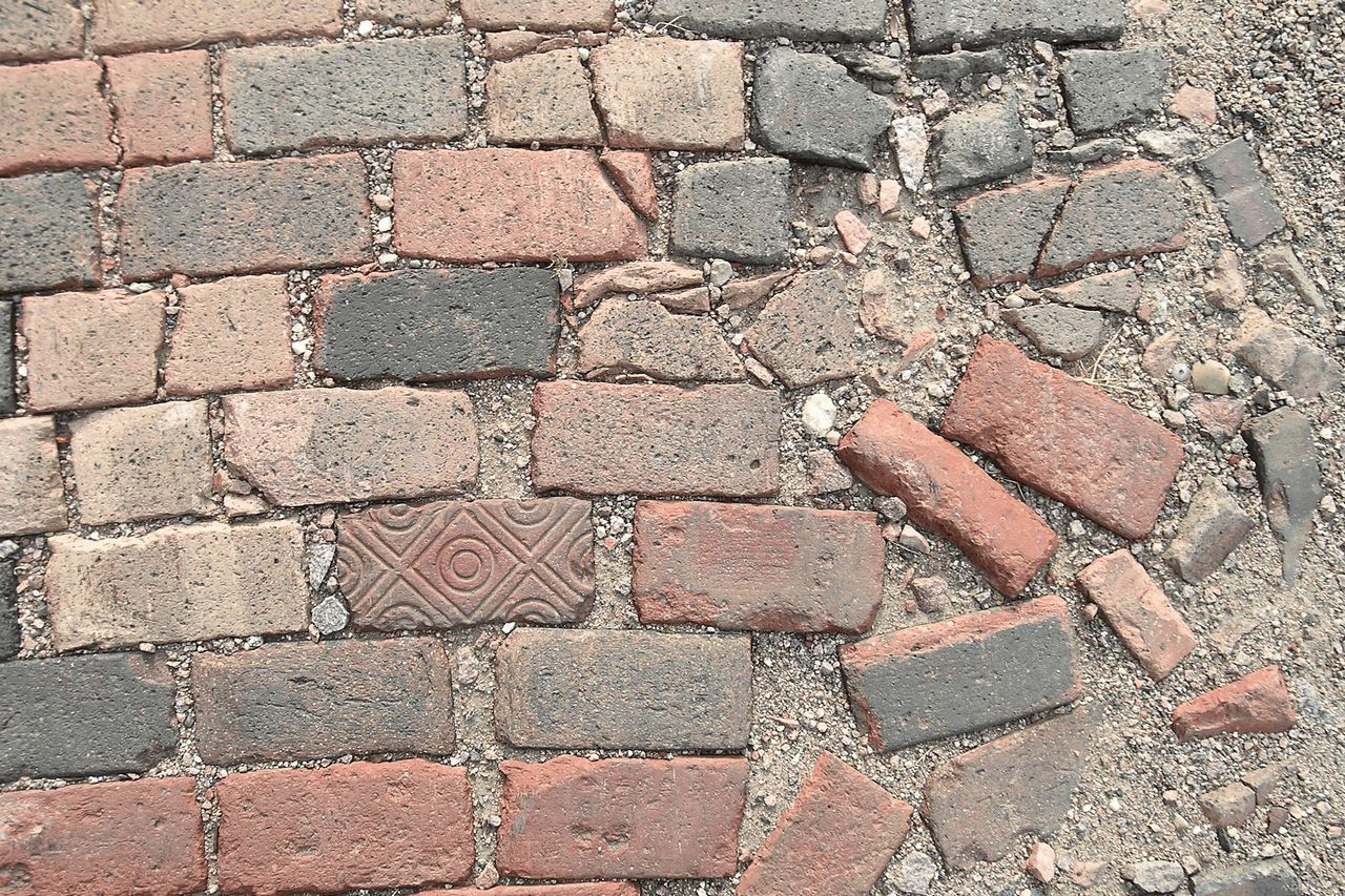 orderly bricks progresing toward chaotic alignment