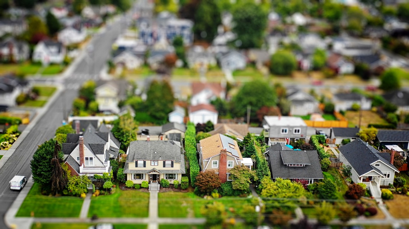 A diorama of a neighborhood with model homes