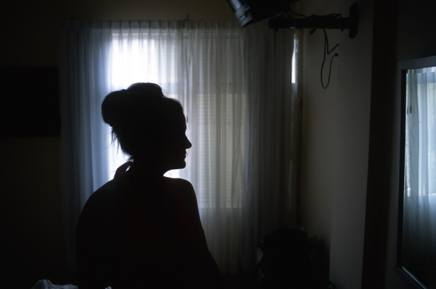 Silhouette of a woman in a room.