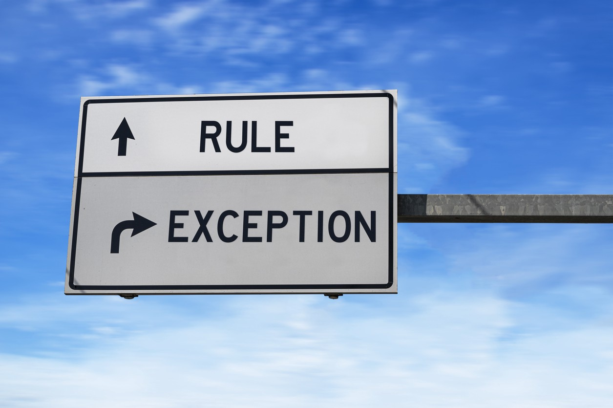 Road signs one says Rule and the other says Exception