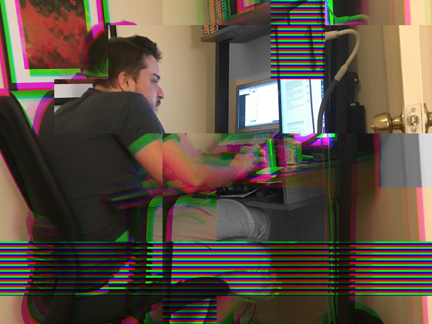 Damon Beres, the author, working on his computer at his home desk.