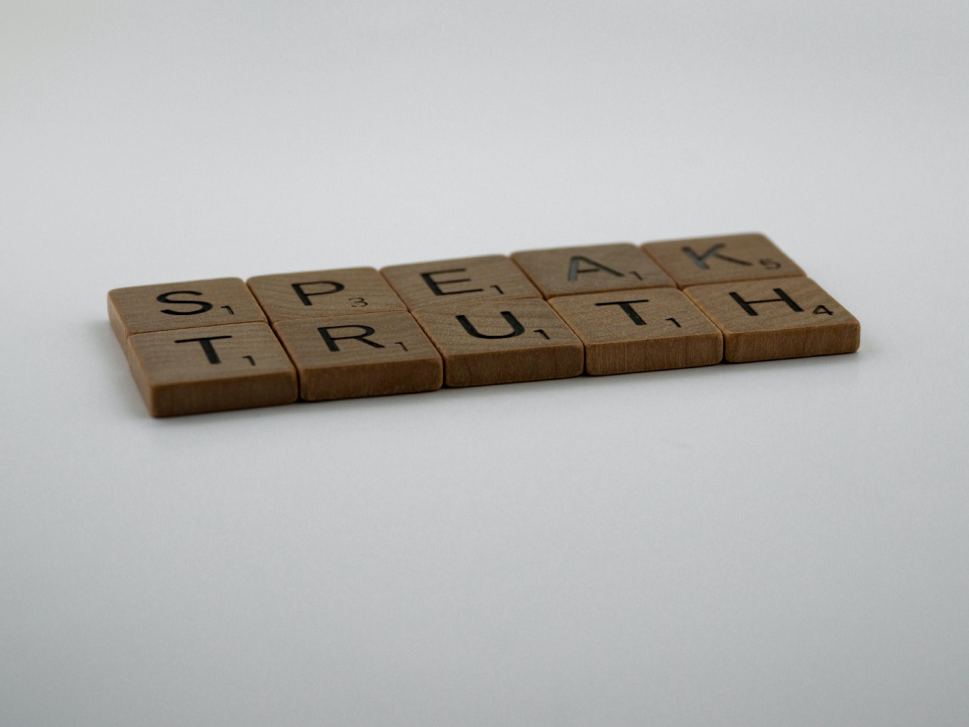 "Wooden letter blocks spelling ""speak truth"""