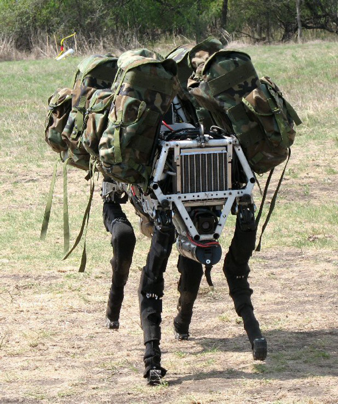 Robot with four legs carrying duffle bags for soldiers in the field.