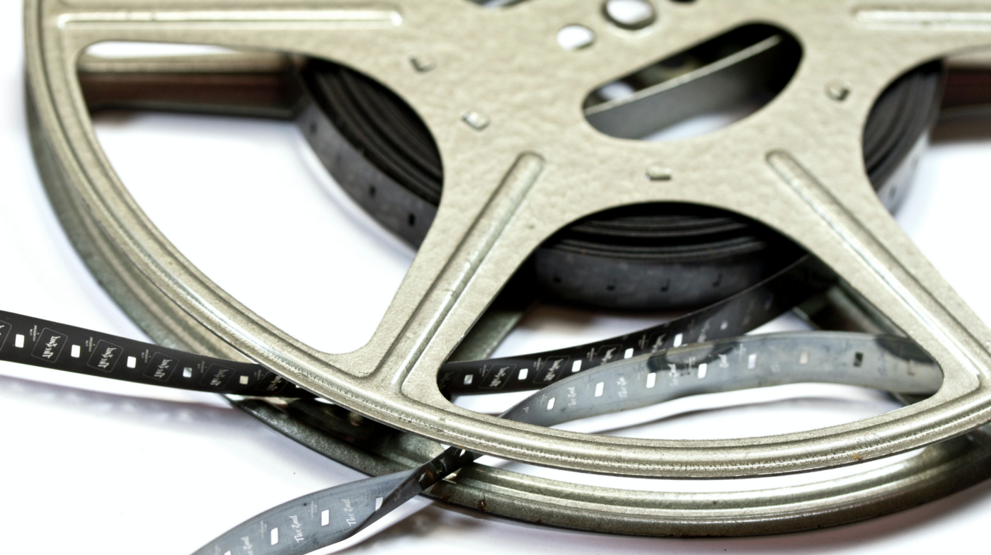 Close up of a film reel on a white background