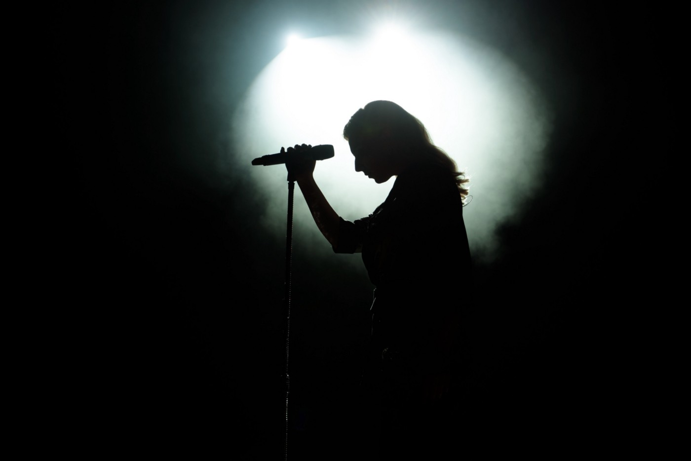 A spotlight shines on a person who is about to perform.