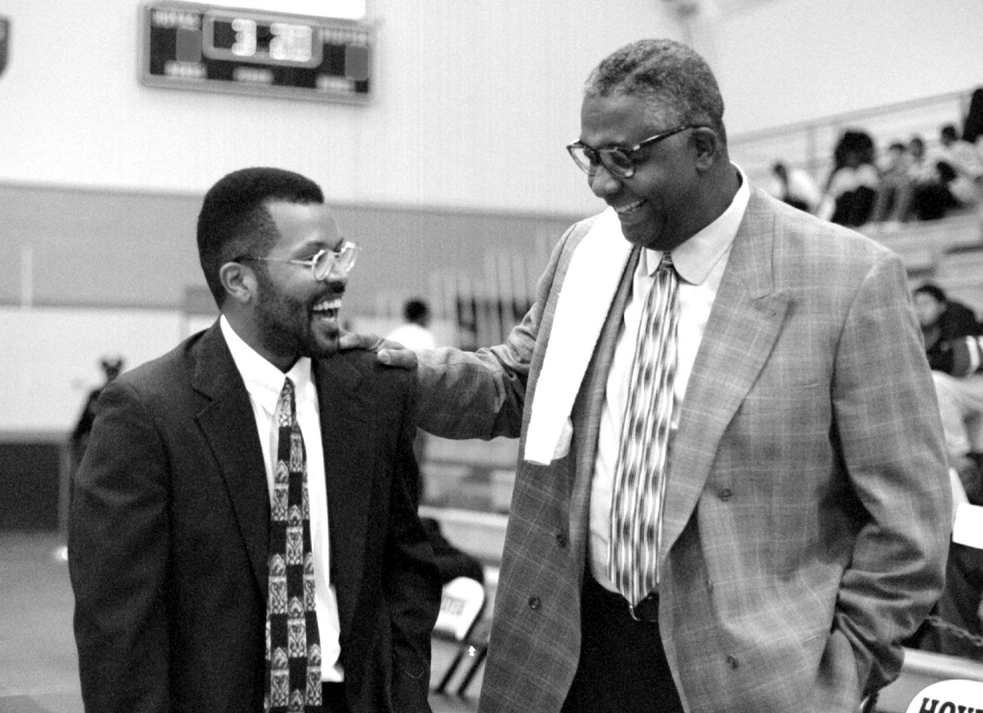Coach Horace Broadnax (left) who played basketball for Georgetown meets with his old coach John Thompson before the game.