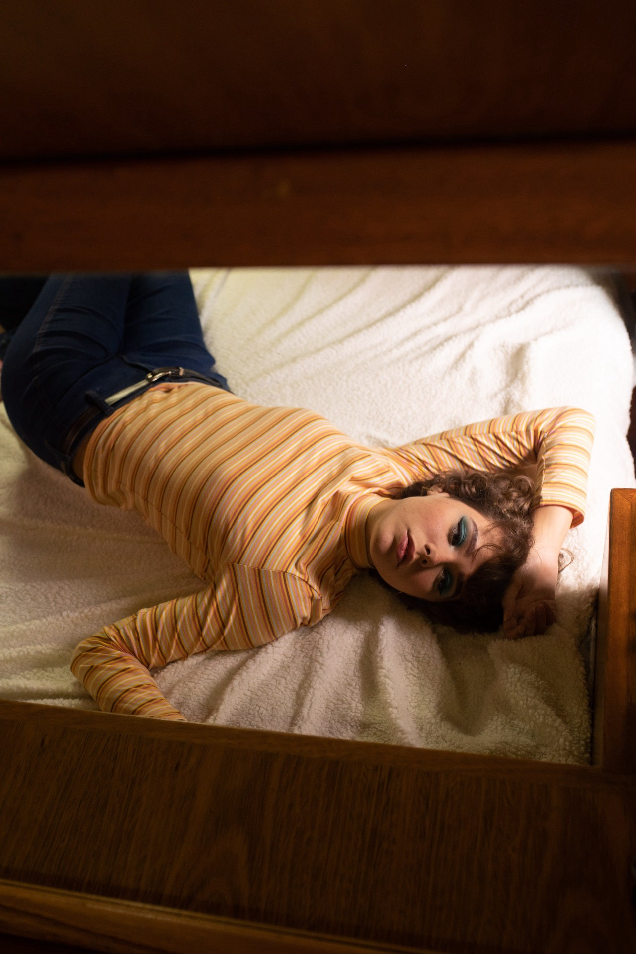 Picture of woman lying on bed