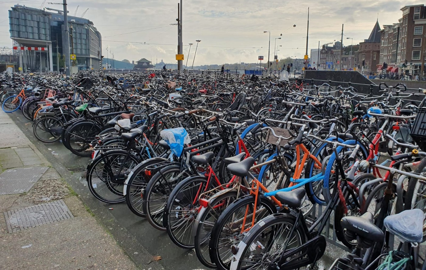 A large amount of bycicles piled together at the central station in Amsterdam