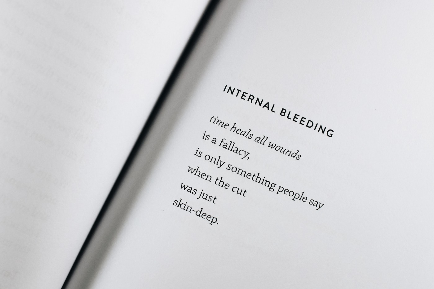 "Book open to a page with a poem titled ""Internal Bleeding"""