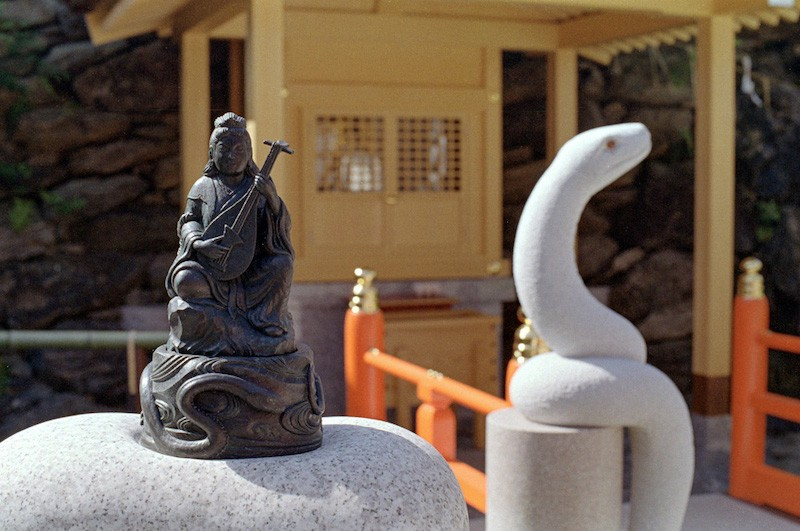 A statue of the Buddhist deity Benzaiten and a white snake