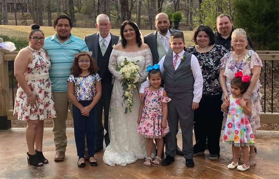 One of my wedding photos with the family that adoption built.