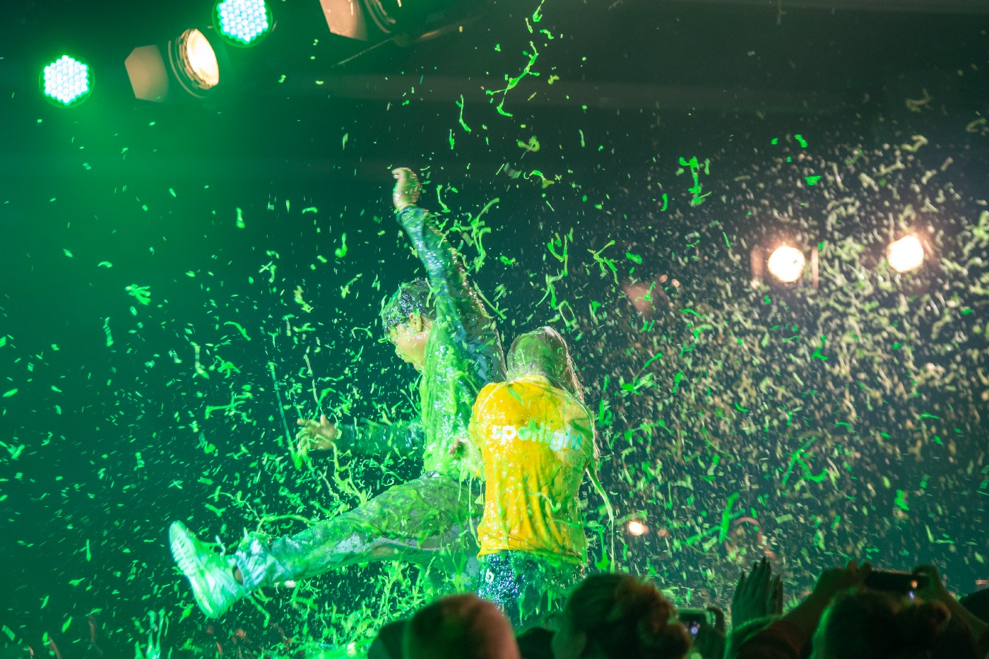 People on a stage get covered in slime.