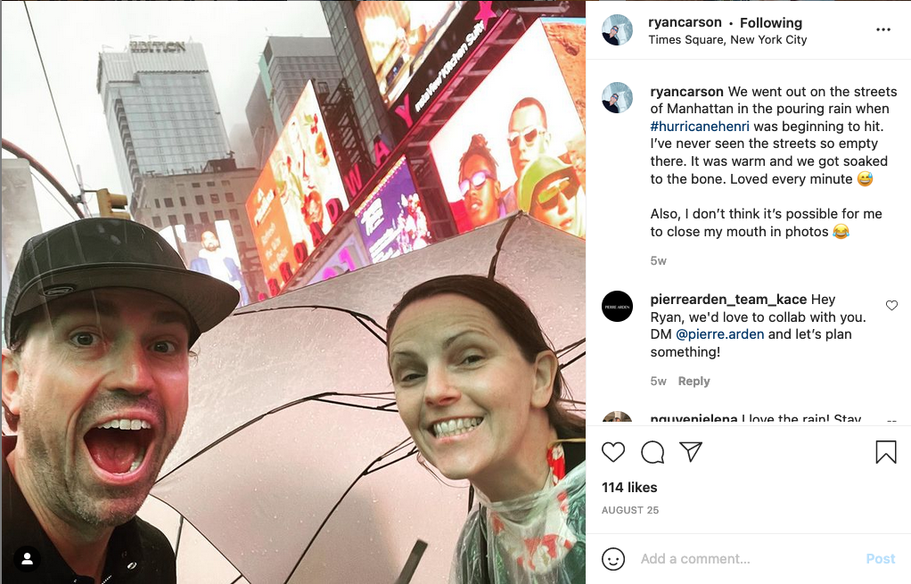Ryan Carson enjoying Times Square. Caption reads 'We went out on the streets of Manhattan in the pouring rain when #hurricanehenri was beginning to hit. I've never seen the streets so empty there. It was warm and we got soaked to the bone. Loved every minute'