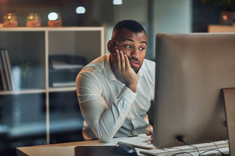 disinterested developer sitting by computer
