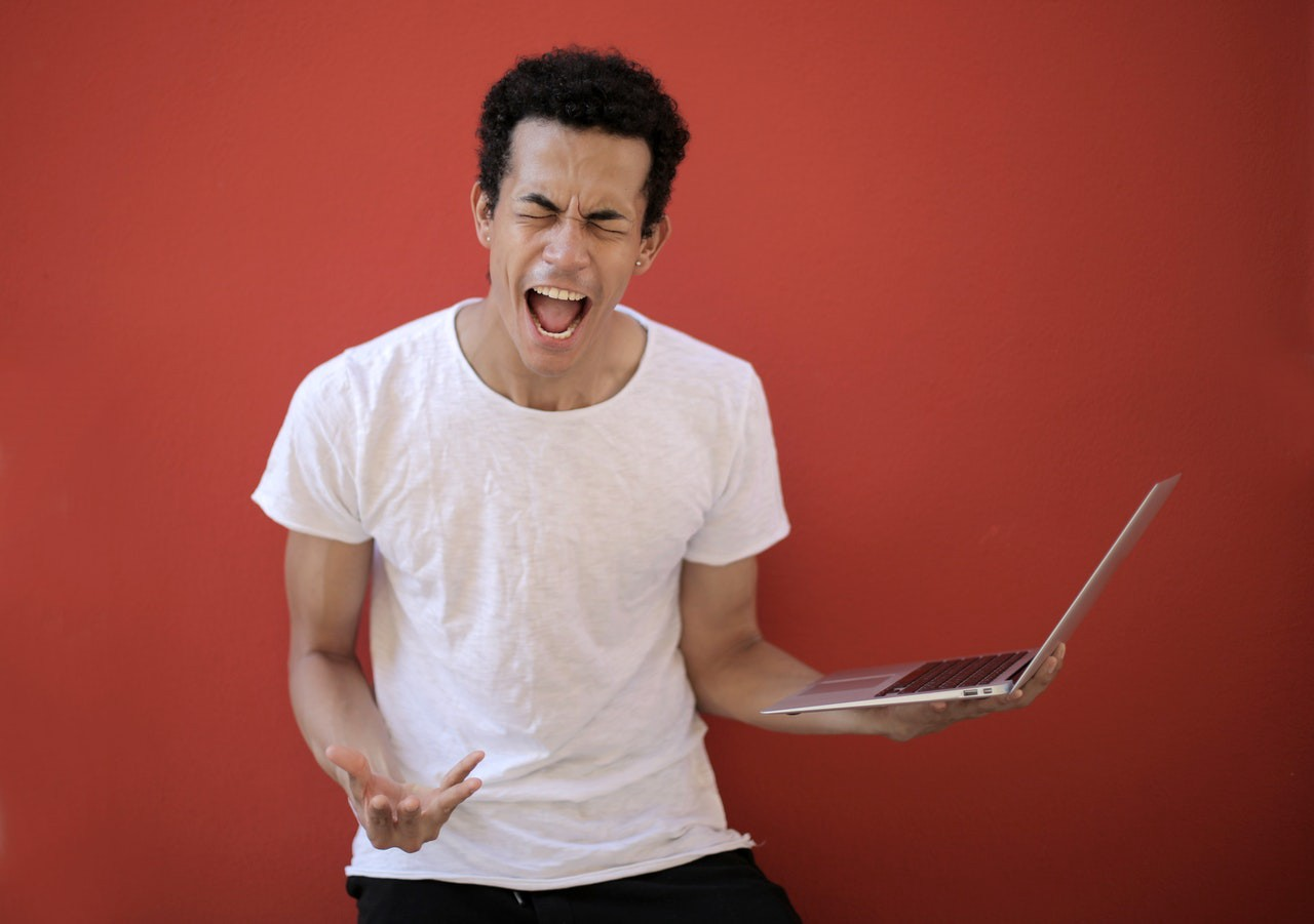 A frustrated freelancer screaming after his work is rejected by a client.