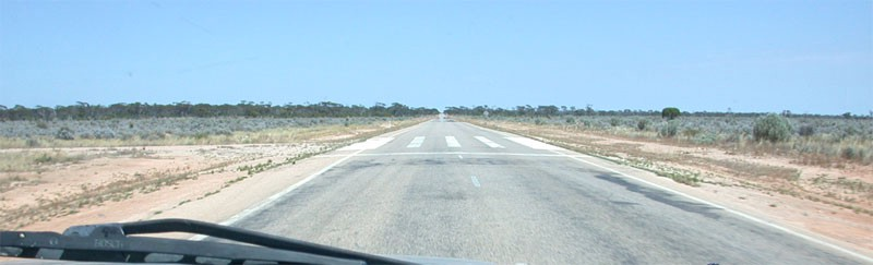 A road through the Australian outback with an emergency airstrip marked on it