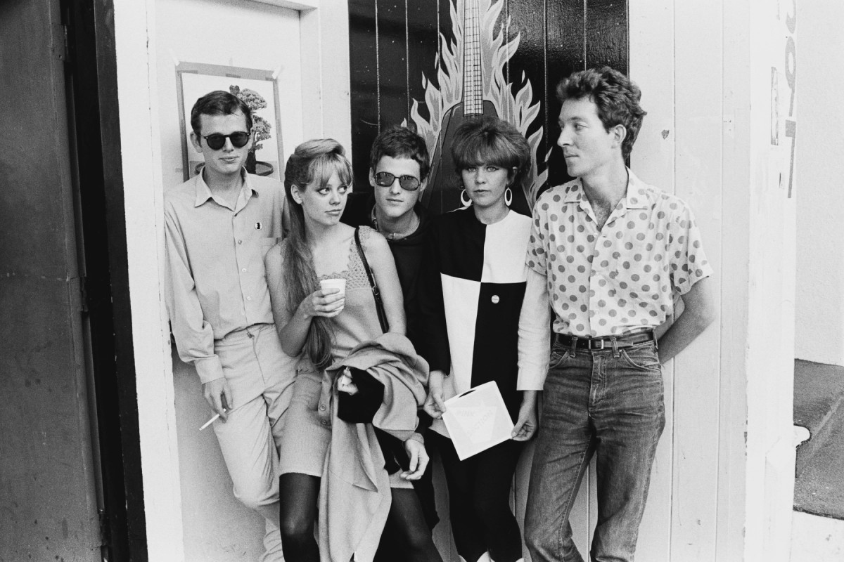 A black and white photo of the band The B-52's.