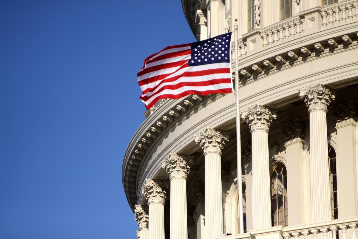 A flag flies outside the US Capitol.