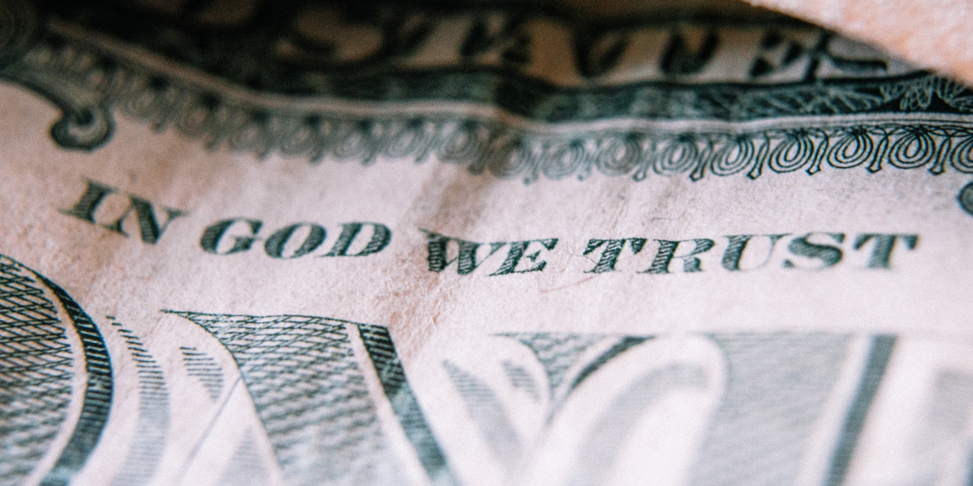 Close up dollar bill with writing in god we trust