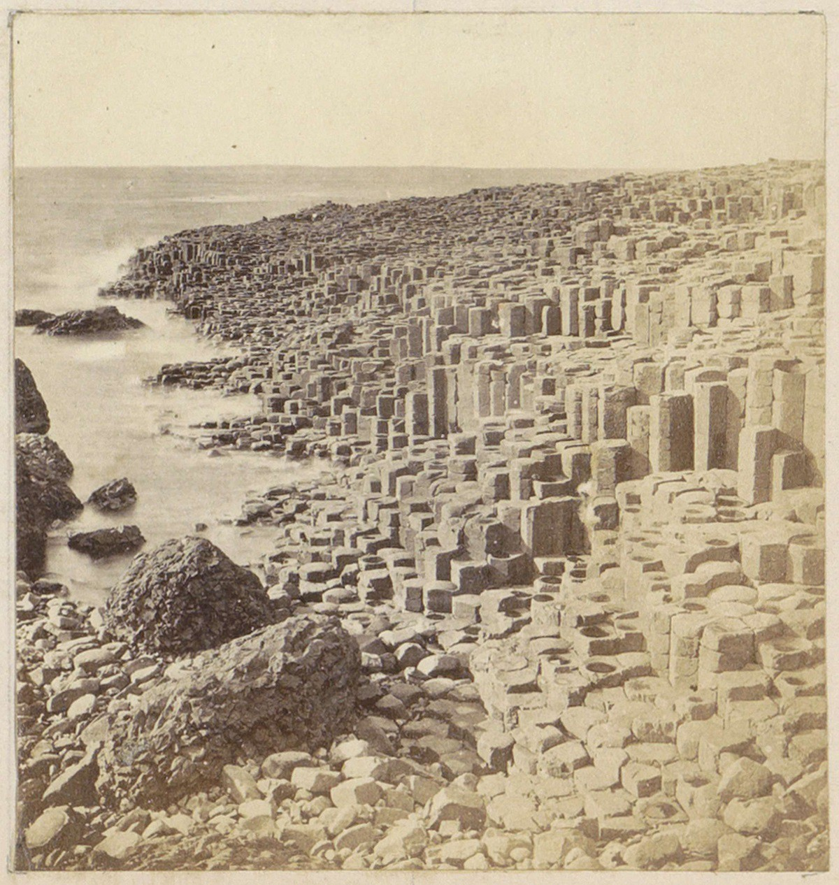Photograph of the Giant's Causeway in Ireland—stones standing upright by the sea
