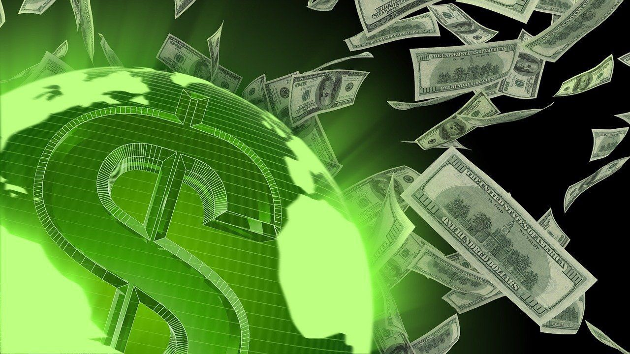 US One-hundred-dollar bills floating about a green global sphere emblazoned with a $ sign.
