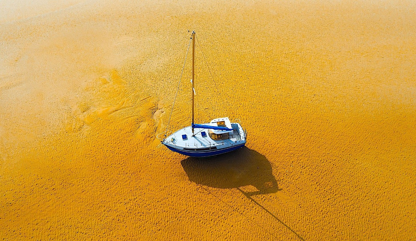 A boat in the middle of the desert