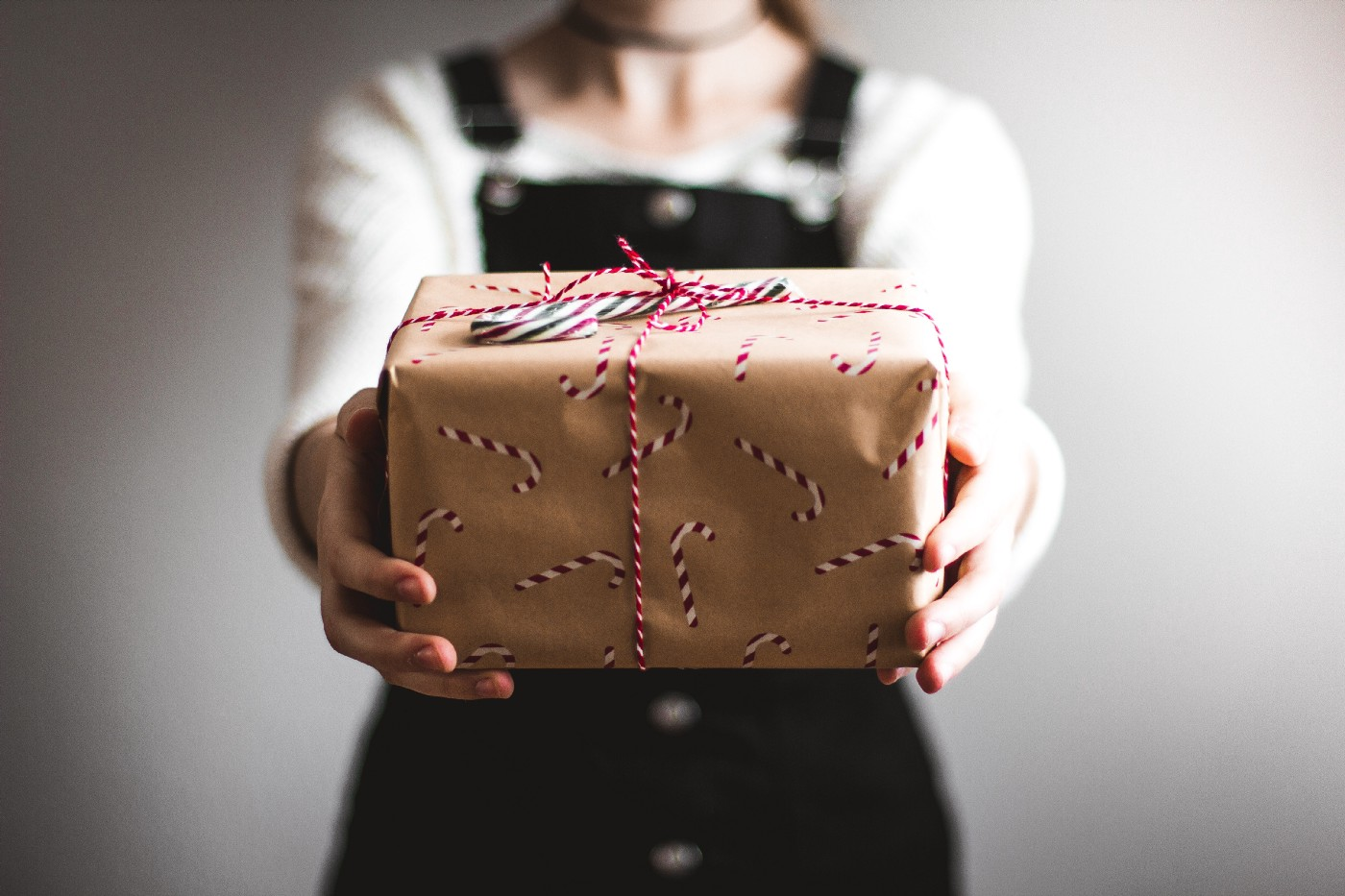 A gift wrapped package, handed out to you, by a delivery person.