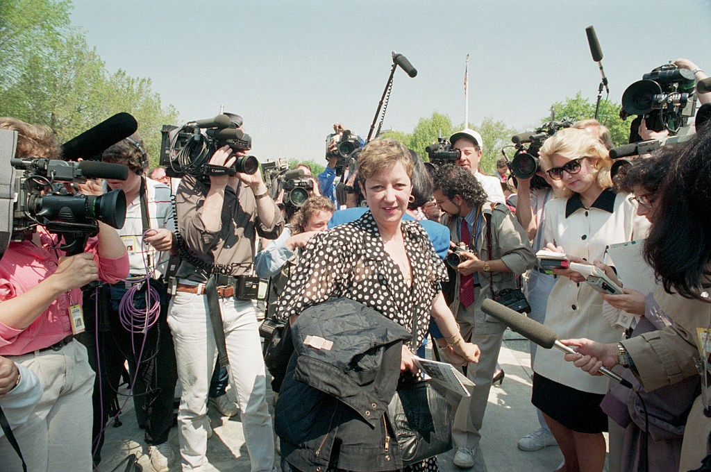 Photo shows McCorvey in front of Supreme Court steps talking to the press in 1989.