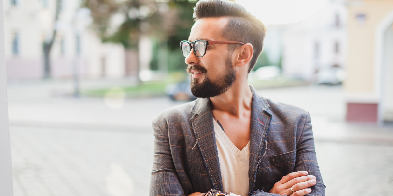 Bearded man with glasses looking to the side—The Surprising Reason Most Women Can't Find A Good Man