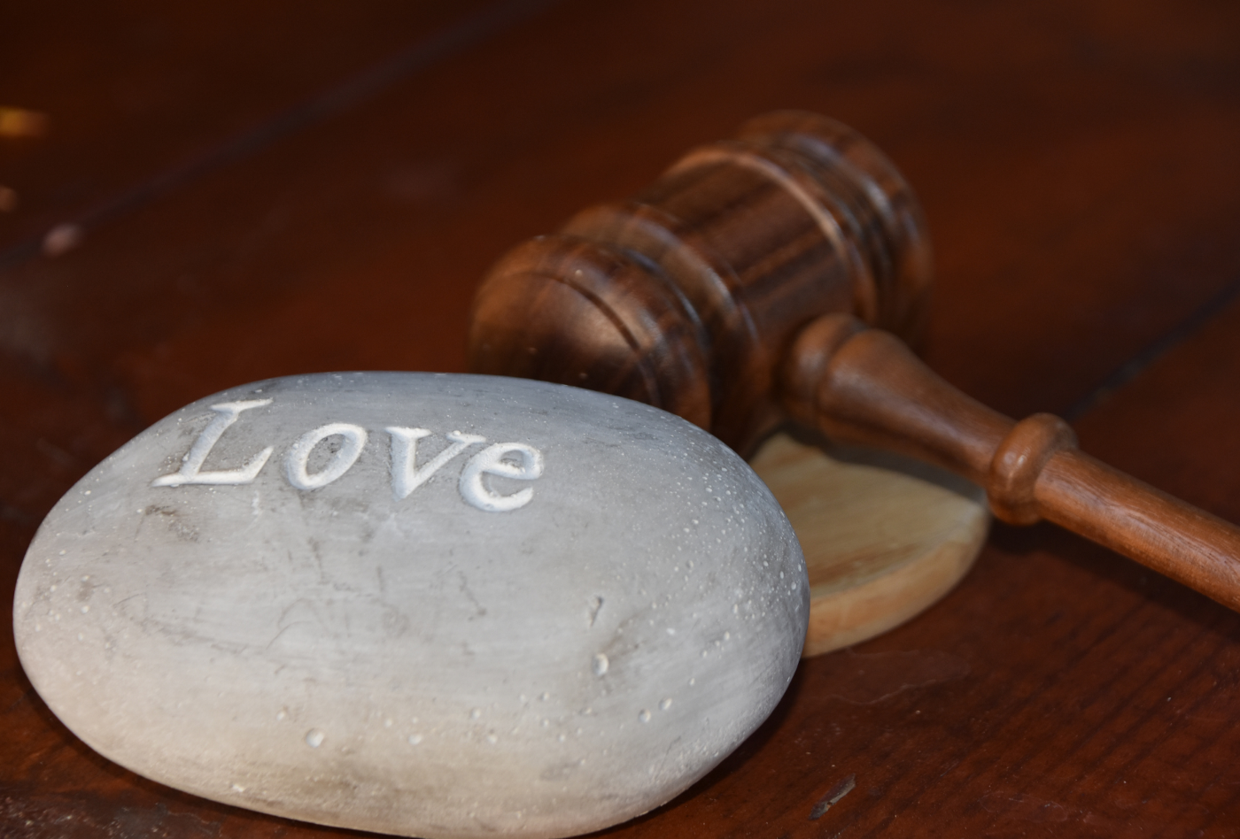 Do We Need Relationship Contracts To Protect Our Sexual Health? | Kara Summers | Stone with love written on it and gavel