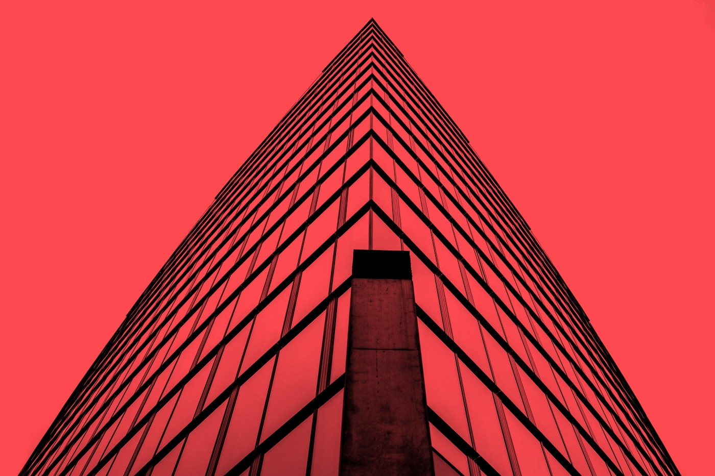 Close up of a modern bank building overlaid in red.