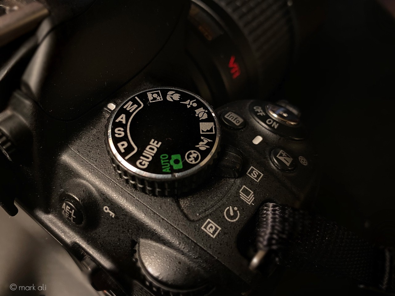 A mode dial on top of a camera.