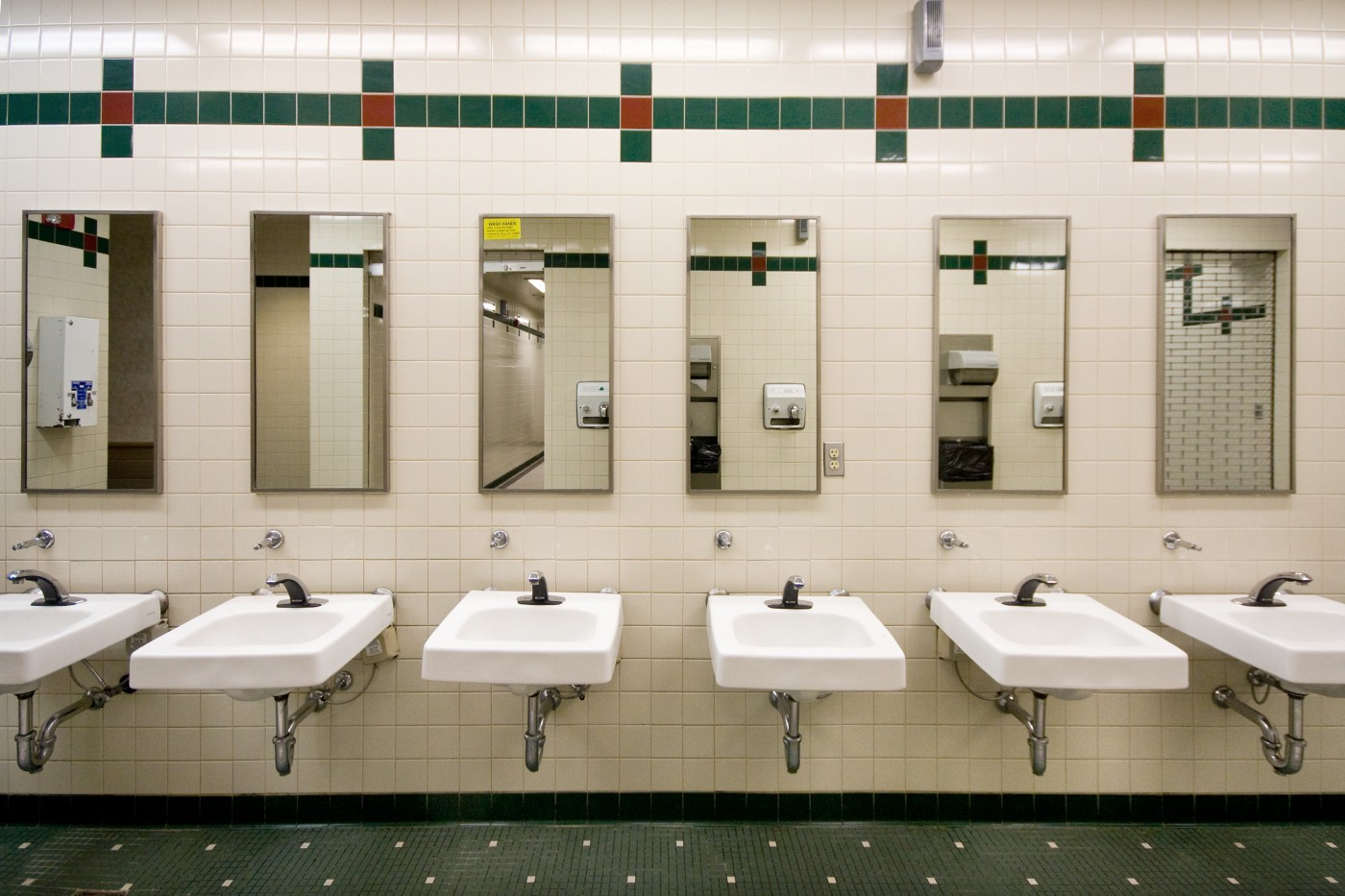 A view of the sinks and mirrors in a public bathroom.