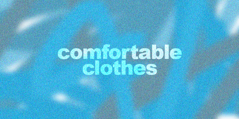 "header image with a burry background that is various shades of blue, the text in white reads ""comfortable clothes"""