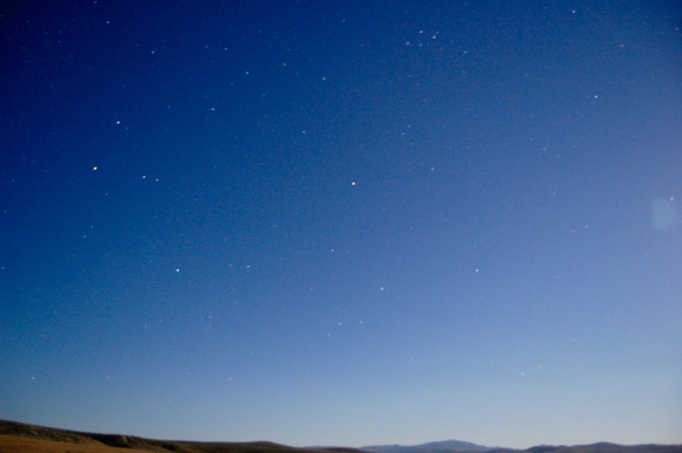 A photo of the blue Oregon summer sky with some stars.
