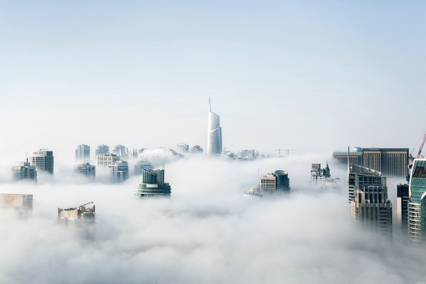 A cityscape viewed from above the clouds.