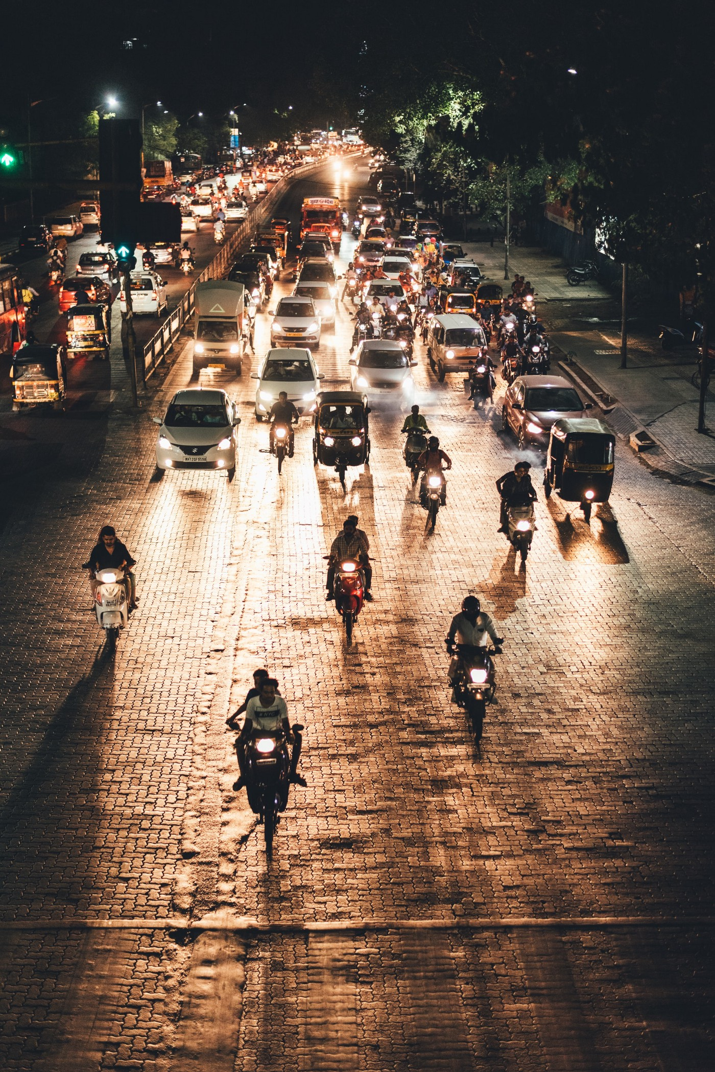 A view of Indian traffic at night, with motorcycles and cars coming toward the viewer
