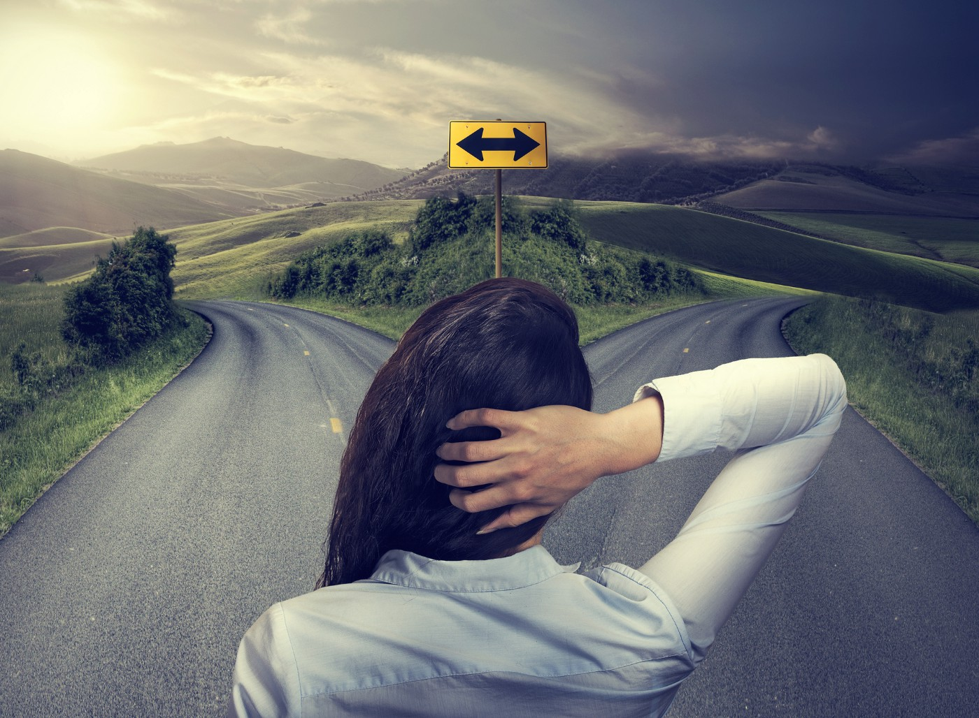 Women looking toward a fork (decision) in the road.