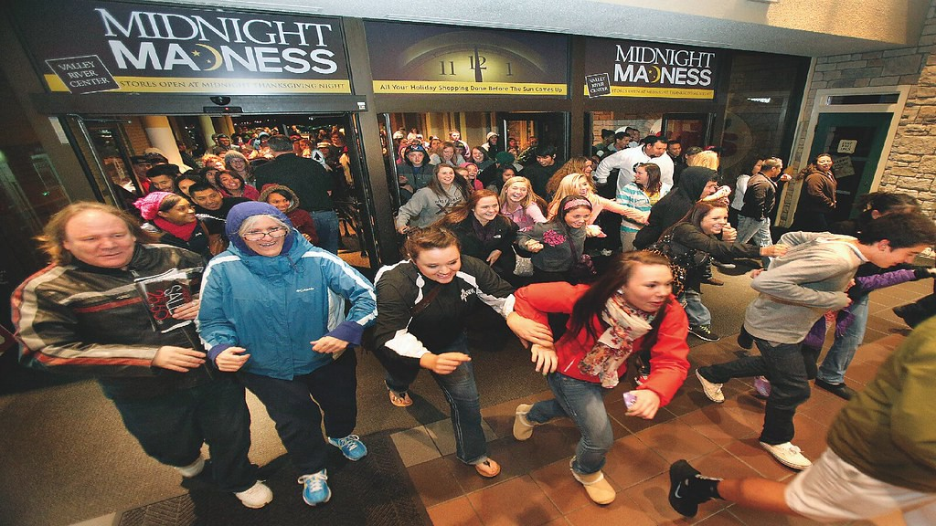 Customers rushing into a retail store during Black Friday