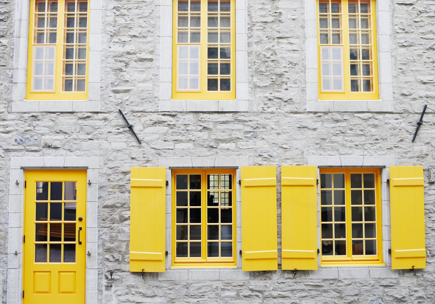 yellow windows on an old stone building