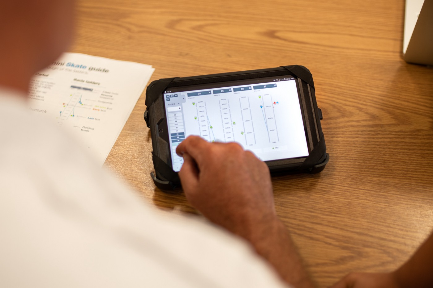 A person taps on a tablet running the MBTA Skate application