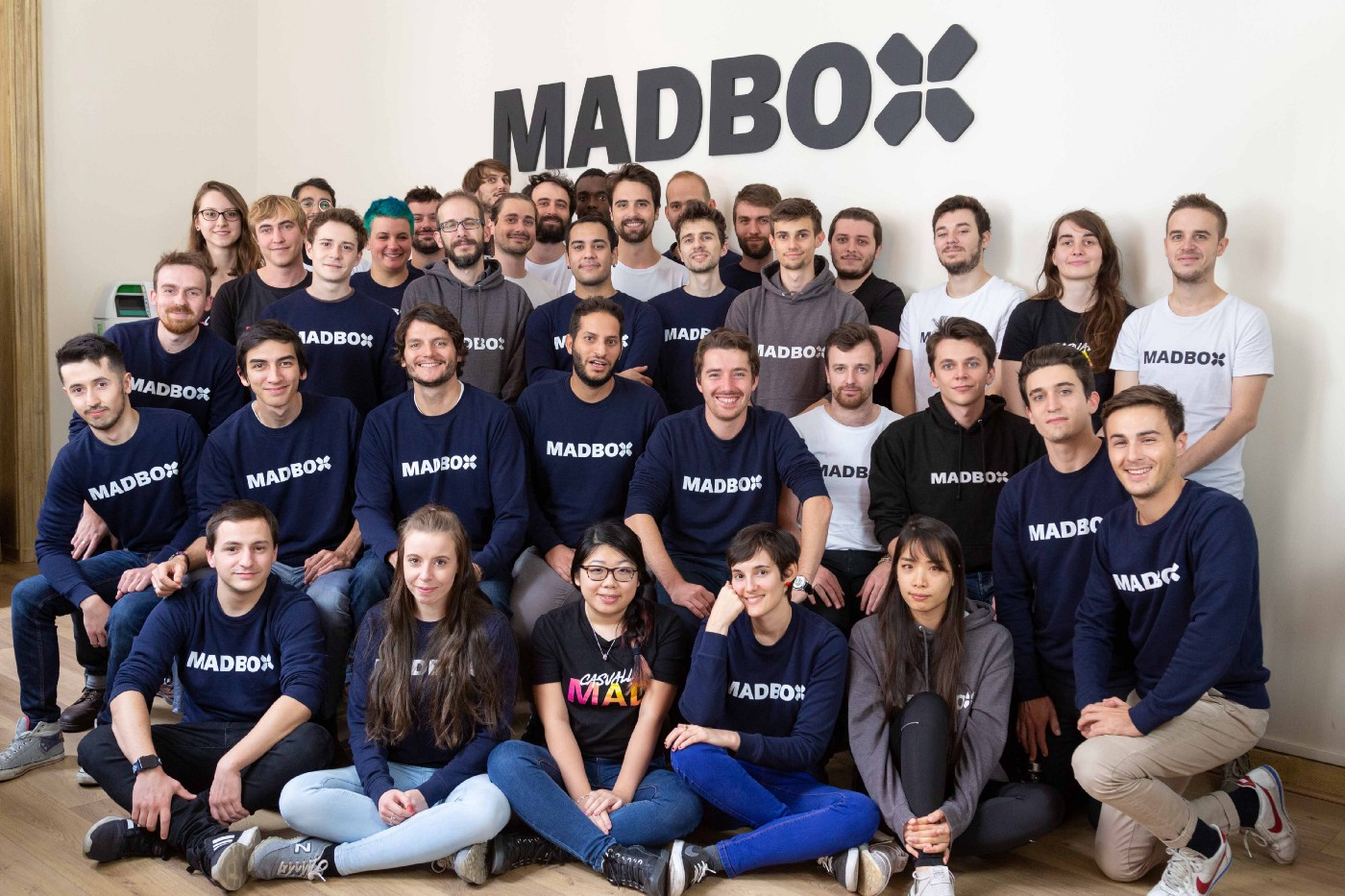 Here you will see the team of people at Madbox Paris gathered for a group photo. Bright with smiles and wearing Madbox branded clothing, they're ready to great mad things. Picture taken in 2019.