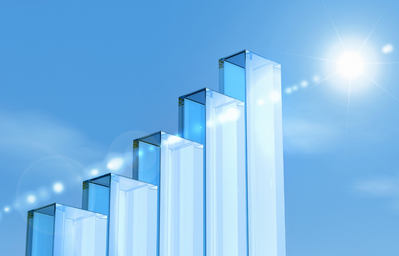 glass pillars forming a bar chart, blue sky and shining sun in the background
