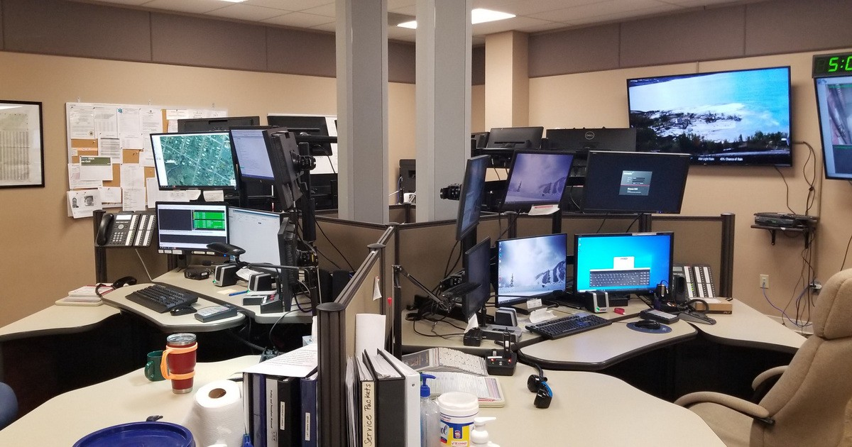 Four dispatch consoles in a cluster.